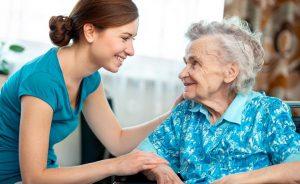 Caregiver Smiling and Meeting Senior