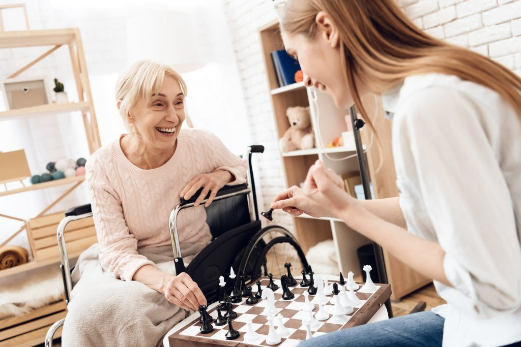 Daughter Playing Chess with Elderly Mother